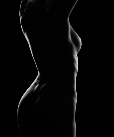 Photo pour Contour-light photo of a Nude ideal female body. Cropped photo of a naked girl with a beautiful body - image libre de droit