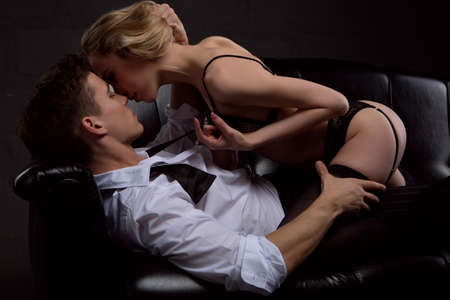 Photo pour Young attractive sexy couple in passionate and tender embrace - image libre de droit