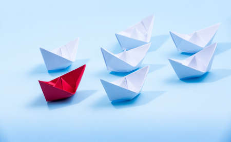 Photo for Red and white paper boats. Concept of leadership boats for teamwork group or success. - Royalty Free Image