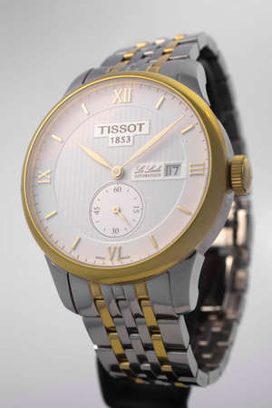 Photo pour Le Locle, Switzerland 15.01.2020 - Tissot man watch woman watch stainless steel case, gold PVD coating white clock face dial, metal bracelet, swiss quartz mechanical watch isolated, swiss made manufacture - image libre de droit