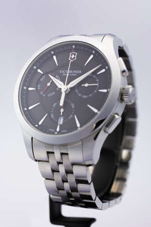 Photo pour Ibach, Switzerland 31.03.2020 - The close up of Victorinox man watch stainless steel case stainless steel bracelet black clock face dial swiss quartz mechanical watch swiss made manufacture isolated on stand - image libre de droit