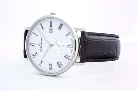 Photo pour Geneve, Switzerland 01.10.2020 - Claude Bernard man swiss made watch white dial leather strap isolated. date indication 26. classic design, Roman numeral Swiss watchmaker, watch manufactory brand - image libre de droit