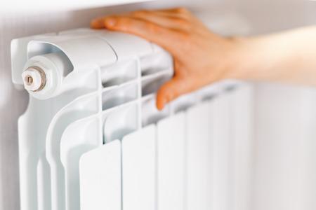 Arm put on  heating white radiator