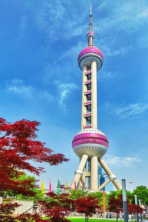 Oriental Pearl Tower on  blue sky background. Tower 470 meter the Oriental Pearl is one of Shanghai's tallest buildings.