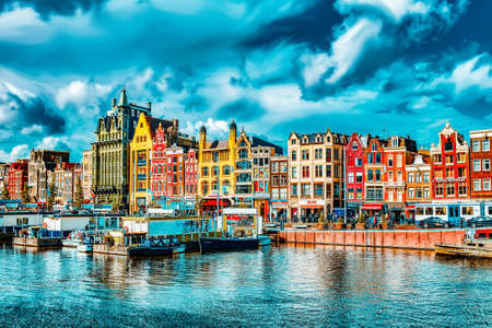 Foto de AMSTERDAM, NETHERLANDS - SEPTEMBER 15, 2015: Beautiful views of the streets, ancient buildings, people in Amsterdam - also call Venice in the North.  Netherland - Imagen libre de derechos