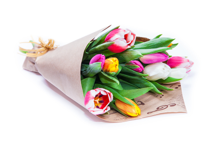 Photo pour the bouquet of tulips is wrapped in a paper isolated on a white background - image libre de droit