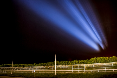 Photo pour The space shuttle Endeavour is seen projected in the sky as powerful xenon lights illuminate launch pad 39a shortly. This image furnished by NASA - image libre de droit