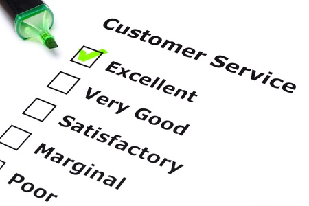 Customer service survey with green tick on Excellent with felt tip pen.