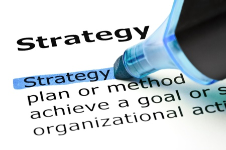 The word Strategy highlighted in blue with felt tip pen