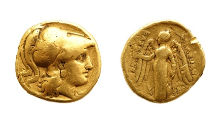 The two sides of an ancient gold coin isolated on white.