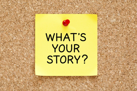 What's Your Story, written on an yellow sticky note pinned on a cork bulletin board.