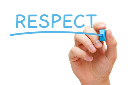 Hand writing Respect with blue marker on transparent wipe board.