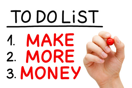Hand writing Make More Money in To Do List with red marker isolated on white.
