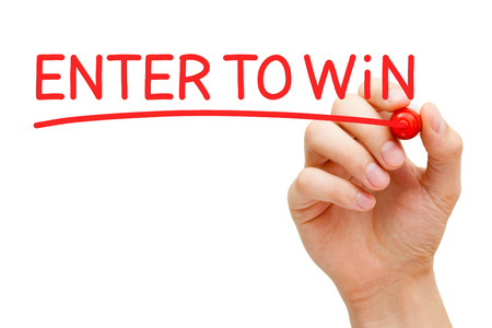 Hand writing Enter to Win with red marker on transparent wipe board.
