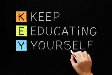 Photo for Hand writing Keep Educating Yourself with white chalk on blackboard. - Royalty Free Image