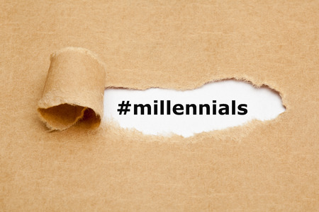 Foto de Hashtag Millennials appearing behind torn brown paper. Millennials, also known as Generation Y, are the demographic cohort following Generation X. - Imagen libre de derechos