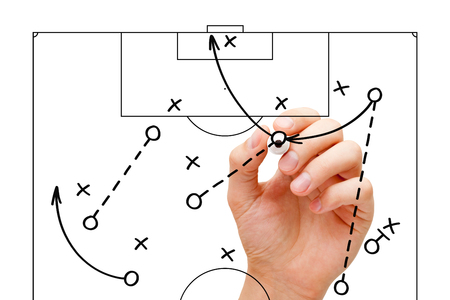 Photo for Coach sketching a football game strategy with marker on transparent wipe board. Soccer coach explaining game tactics. - Royalty Free Image