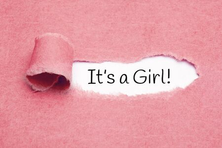 Photo pour Announcement It Is A Girl appearing behind ripped pink paper. Newborn baby girl card. - image libre de droit