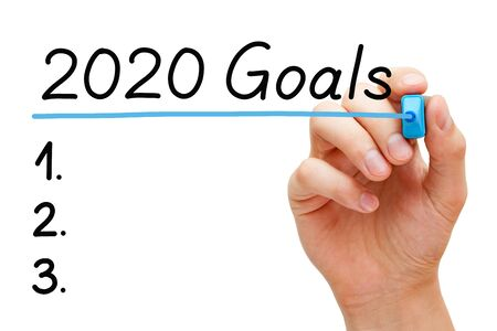 Photo for Blank goals to do list concept for year 2020 isolated on white background. Hand underlining 2020 Goals with blue marker on transparent wipe board. - Royalty Free Image