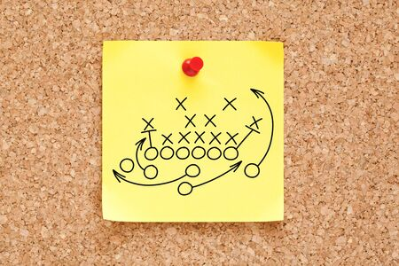 Photo pour American football or rugby game playbook, strategy or tactics drawn on yellow sticky note pinned on bulletin cork board. - image libre de droit