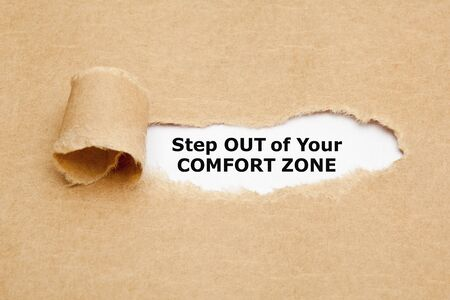 Photo pour Motivational quote Step out of your comfort zone. appearing behind ripped brown paper. - image libre de droit