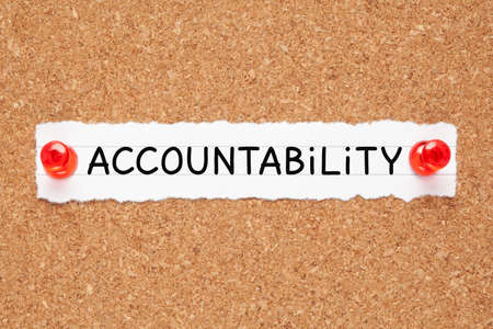 Photo pour The word Accountability handwritten on a piece of white paper pinned on cork bulletin board. - image libre de droit
