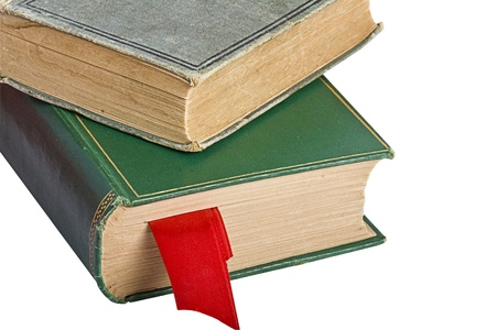 Two old books with a red bookmark isolated on white