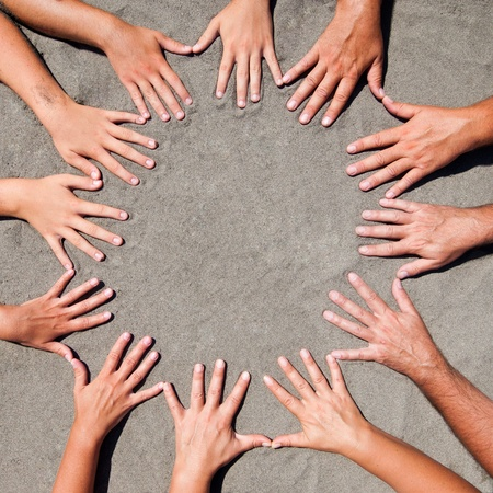 Image of  hands on sand - circle form