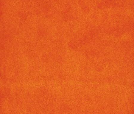 Background with orange texture velvet fabric closeup