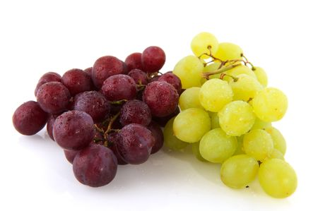 Fresh red and white grapes with water drops isolated over white