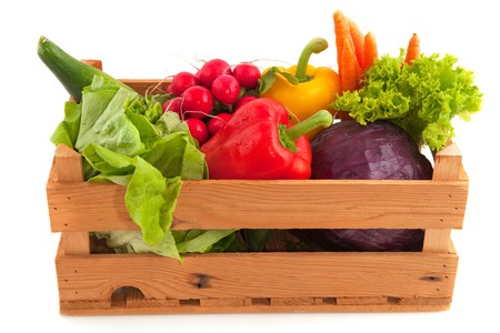 Wooden crate with a diversity of fresh vegetablesの写真素材