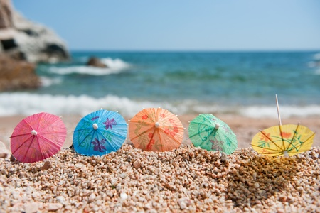 Colorful Chinese paper parasols for shade at the sunny beach