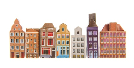 Row typical houses from Amsterdam isolated over white background