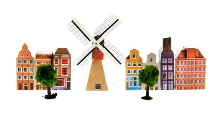 Typical Dutch village with windmill isolated over white background