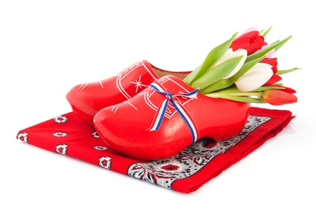 Red Dutch wooden clogs with colorful tulips on handkerchief