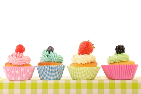 assortment fruit cupcakes isolated over white background