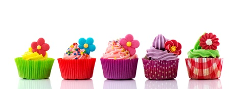 Row colorful cupcakes with buttercream flowers and confetti