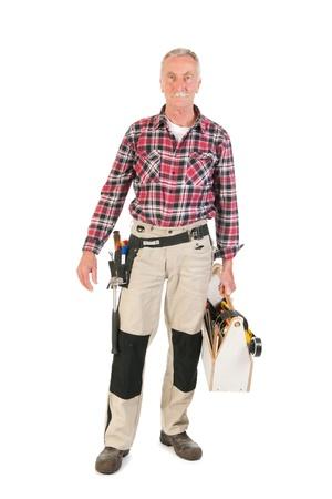Photo pour Senior man as manual worker carrying wooden toolkit - image libre de droit