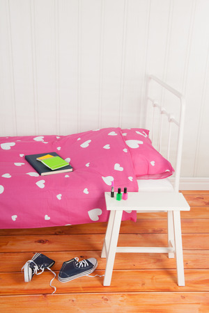 Girls bedroom with pink bed