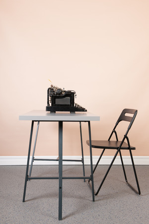 Empty desk at the office with old black typewriter