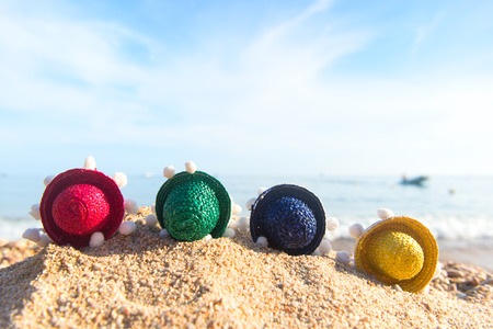 Colorful straw sombreros at the beach
