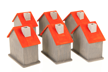 Row wooden houses same in gray and red isolated over white background