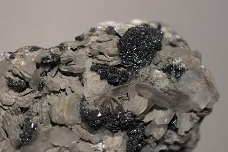 silver ore on rock close up macro