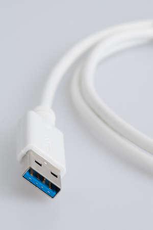 White USB Cable on a white backrgound
