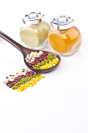 Beans and spices - colorful with different angle in wood spoon and bottle