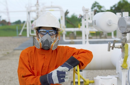 Technician of oil and gas worker open up the valve