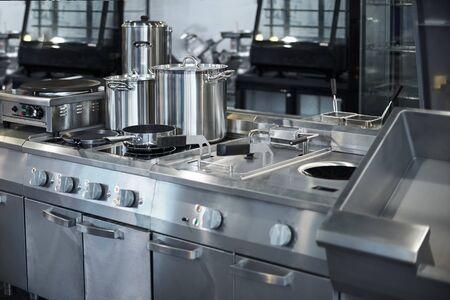 Foto für Work surface and kitchen equipment in professional kitchen, view counter in stainless steel . Bokeh . - Lizenzfreies Bild