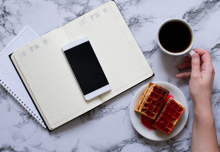 woman hand, cup of coffee, planning day, business lunch and smartphone
