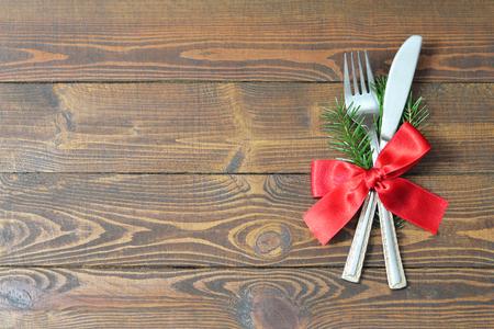 Photo pour Christmas silverware on wooden table - image libre de droit