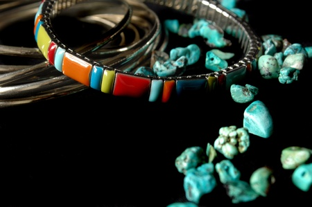 Bracelets and jewelry with turquoise on a black background